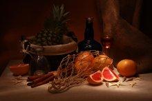 Кубинский темный ром / Натюрморт с ромом и красными грейпфрутами