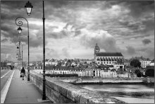 Going Home / A lady walking back home across the bridge over the Loire river...