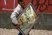 Streets of Lisbon / Just an occasional shot of man carrying a mirror near flea market in Lisbon.