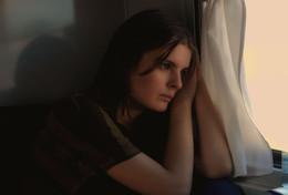 в думках / она сидела у окошка в вагоне поезда в думках. мне понравился, как лег свет, и я втихаря ее сфотографировала.