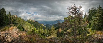 Waiting for the Miracle / Approaching rainy evening. Wind combing the forest in rare sunshine and the shadows of the olden clouds descend into the valley, preparing to absorb the life-giving moisture, to rise with it to the sky and again reborn, repeating its karmic circle ...   This artwork is also available in the spherical panorama technique here: https://www.360cities.net/profile/awesome/image/overcast-mountain-landscape-neviasta-mount-smolyan-bulgaria  The native resolution 18262 x 7701px is available by special request.   Shooting and processing method: stitching panoramic, 2 rows of 8 photos with overlapping, HDR from 5 steps exposure bracketing.